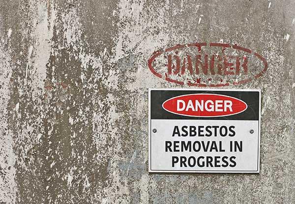 asbestos removal in progress sign